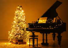 Grand Piano In Room Decorated For Christmas At Night