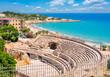Ancient Roman Amphitheater and Tarragona cityscape, Catalonia, Spain