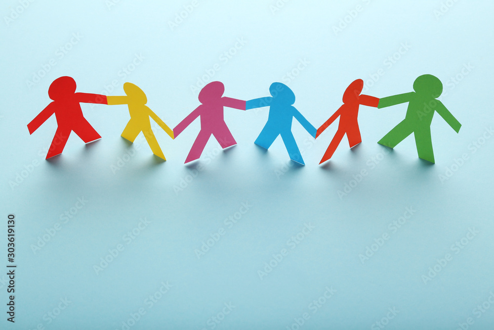 Fototapeta Colorful paper chain people on blue background