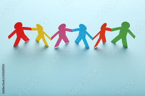 Fotografiet Colorful paper chain people on blue background