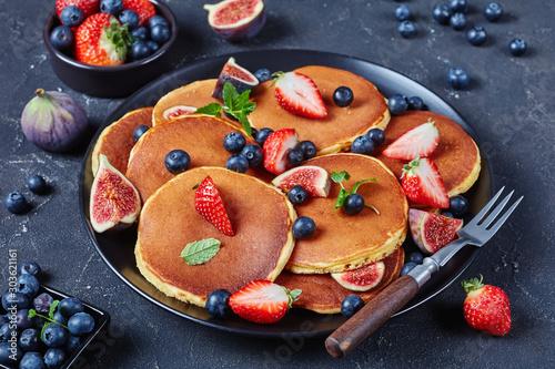 almond pancakes on a black plate, close-up - 303621161