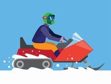 Man Riding Snowmobile In Winte...