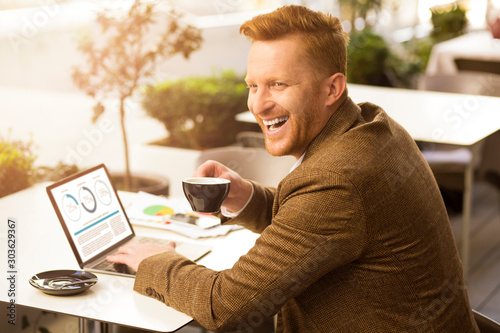 Obraz Delighted manager during coffee break stock photo - fototapety do salonu