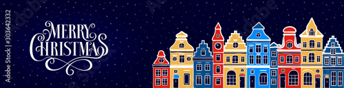Obraz Winter urban landscape. Old european town. Cityscape. Сolorful old houses. Cartoon buildings.Merry Christmas hand drawn inscription. Lettering. Greeting card, postcard, template, frame, cover, poster - fototapety do salonu