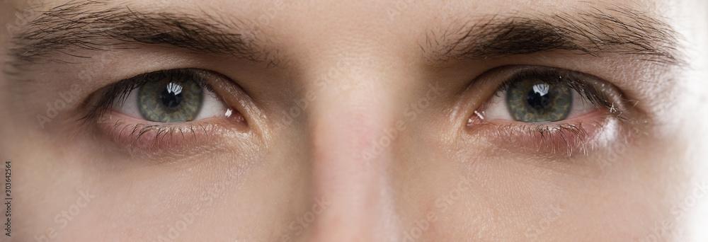 Fototapeta Closeup of male eyes
