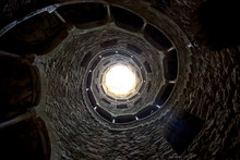 A Sunken Town With A Spiral Staircase