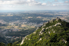A Vista Of A Mountainside And Plains