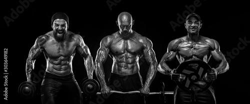 Three strong and fit men bodybuilders Fototapeta