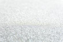 Defocused Sliver Glitter Background. Gold Abstract Bokeh Background. Christmas Abstract Background