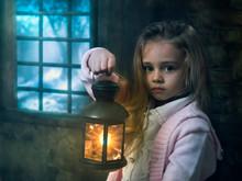 A Little Girl With A Lantern B...