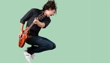 Male Guitarist Playing Music O...