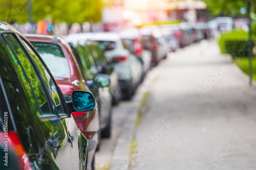 Cars parked in the parking lot - 303660398