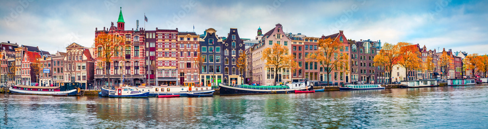 Fototapeta Panoramic autumn view of Amsterdam city. Famous Dutch channels and great cityscape. Colorful morning scene of Netherlands, Europe. Traveling concept background.