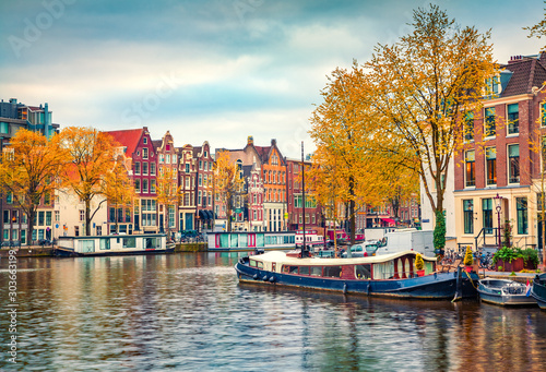 Fototapeta Amsterdam  splendid-autumn-scene-of-amsterdam-city-famous-dutch-channels-and-great-cityscape-colorful-morning-landscape-in-netherlands-europe-traveling-concept-background