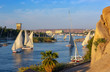 Beautiful landscape with felucca boats on Nile river in Aswan at sunset, Egypt
