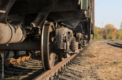 Photo Stands Ship Freight car (boxcar), angled view of chassis, suspension and metal wheels, close-up