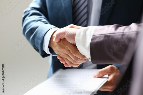 Man in suit shake hand as hello in office Fototapeta