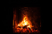 A Fire Burns In A Fireplace, C...