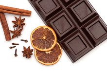 Dark Chocolate, Dried Orange, Anise, Cinnamon, Cloves - Composition. Isolated On White Background.