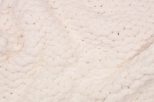 Cozy Knitted Thick Wool Blanket. Full Wavy Texture Background. Cream Color.