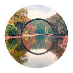 Fototapeta Las Round icon of nature with landscape. Impressive morning view of Rakotz Bridge (Rakotzbrucke, Devil's Bridge) in Azalea and Rhododendron Park Kromlau, Germany, Europe.Photography in a circle.