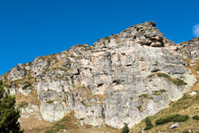 Panorama Of The Mountain Range. Blue Clear Sky, Sunny Weather, Morning. Sheer Hillside, Cliff. Seven Rila Lakes, Bulgaria