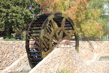 Fall Foilage And  Beautiful Wooden Waterwheel