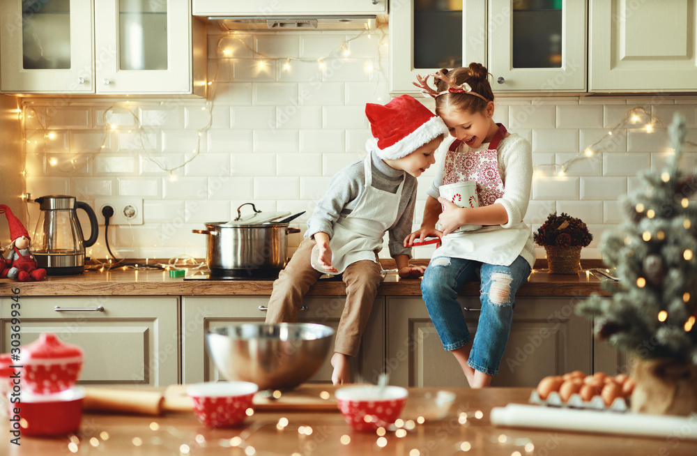 Fototapety, obrazy: happy children boy and girl bake christmas cookies
