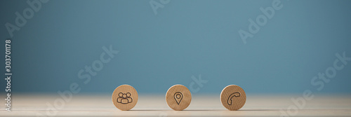 Fotografía Wide view image of three wooden cut circles with contact and information icons o