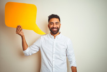 Young Arab Indian Hispanic Man Holding Speech Bubble Over Isolated White Background With A Happy Face Standing And Smiling With A Confident Smile Showing Teeth