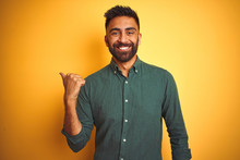 Young Indian Businessman Wearing Elegant Shirt Standing Over Isolated White Background Smiling With Happy Face Looking And Pointing To The Side With Thumb Up.