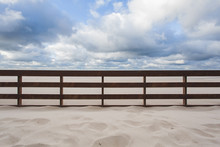 Wooden Fence In The Sand On Th...