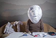 A Man With A Paper Lion's Head...