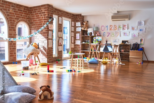 Fototapeta Picture of preschool playroom with colorful furniture and toys around empty kindergarten obraz