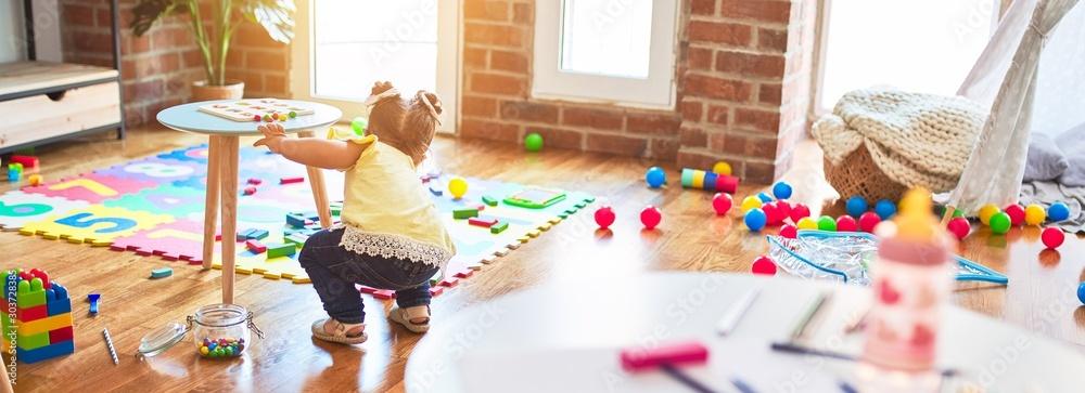 Fototapeta Beautiful toddler playing at kindergarten