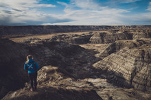 Young Blonde Woman Hiked To Horsethief Canyon Lookout To Admire Nature Beauty Of UNESCO Heritage Site, Drumheller, Alberta, Canada