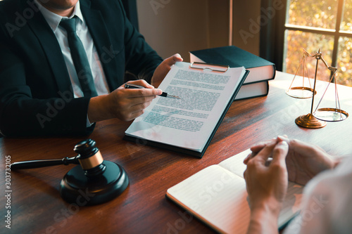 Fototapeta Man judge is currently advising clients on their requests for legal proceedings and legal advice