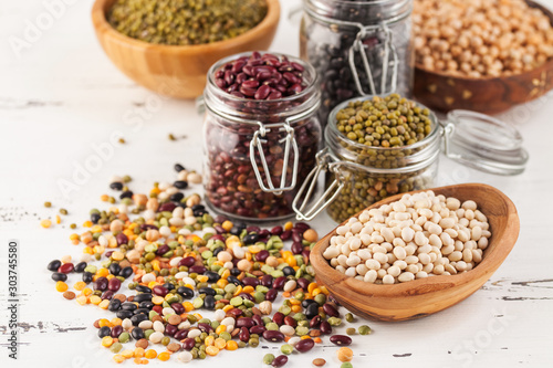 Assortment of dry organic beans and lentils in glass jar