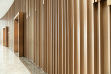 Detail Of Random Wooden Strip Wall In Vertical Direction At Pre-function Space / Interior / Natural Light