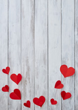 Red Paper Hearts On White Wood...