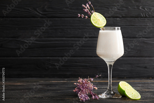Foto auf Leinwand Alkohol Glass of tasty Pina Colada cocktail and lavender on table