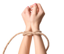 Female Hands Tied With Rope On...