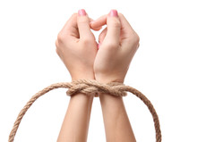 Female Hands Tied With Rope On White Background