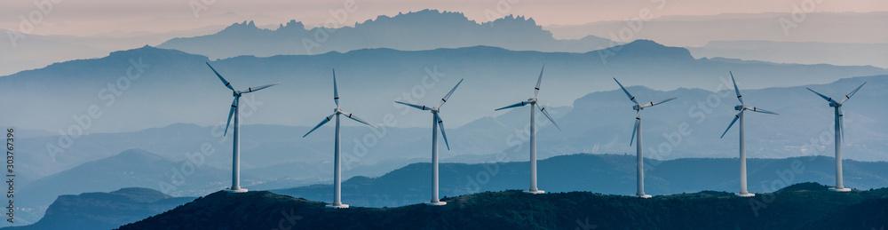 Fototapeta Renewable energy, wind energy with windmills
