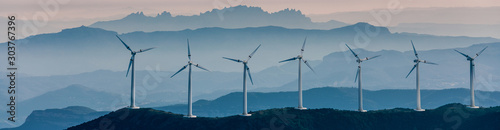 Obraz Renewable energy, wind energy with windmills - fototapety do salonu