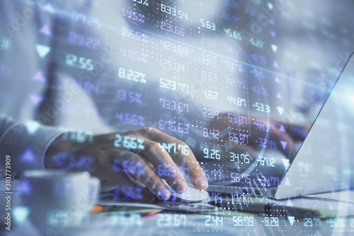 Double exposure of forex graph with man working on computer on background. Concept of market analysis.