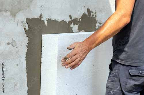 Obraz Insulation of facade wall with styrofoam sheets. Polystyrene insulation boards with glue adhesive. - fototapety do salonu
