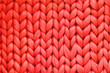 canvas print picture - Texture of red wool big knit blanket. Large knitting. Plaid merino wool. Top view