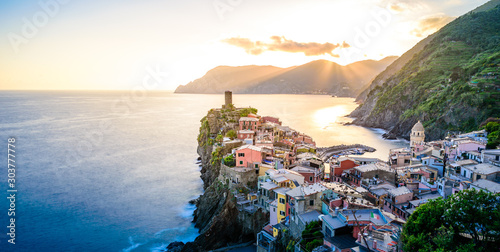 Fotobehang Noord Europa Vernazza - Village of Cinque Terre National Park at Coast of Italy. Beautiful colors at sunset. Province of La Spezia, Liguria, in the north of Italy - Travel destination and attraction in Europe.