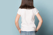 canvas print picture - Close up back view little brown-haired girl.